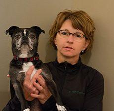 Dr. Terri Chotowetz holding a dog