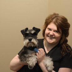 Raelynn Myers holding a dog